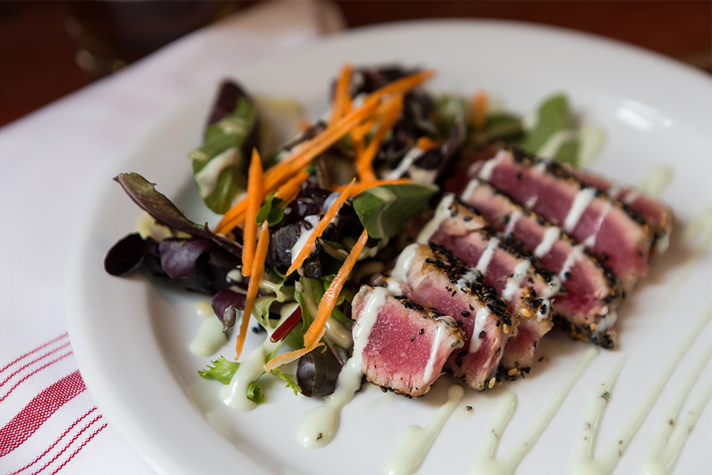 Image of Hawaiian Tuna - Sesame Crusted Seared Tuna, Champagne Vinaigrette Dressed Greens, Shredded Carrot, Wasabi Aioli