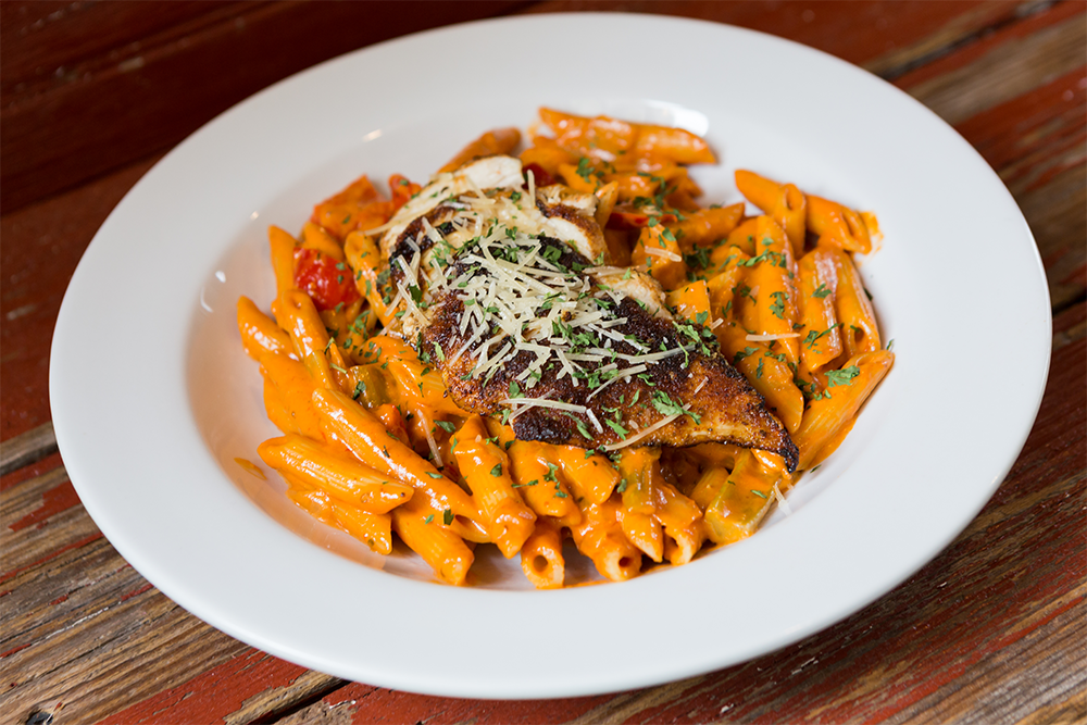 Image of New Orleans Pasta - Blackened Chicken, Penne Pasta, Holy Trinity Vegetables, Spicy Creole Cream Sauce