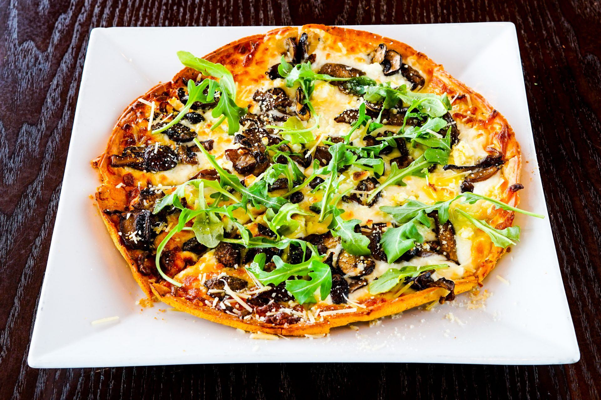 Image of Kennett Square Mushroom - Caramelized Mushroom, Baby Arugula, Mozzarella & Goat Cheese, Garlic Oil,