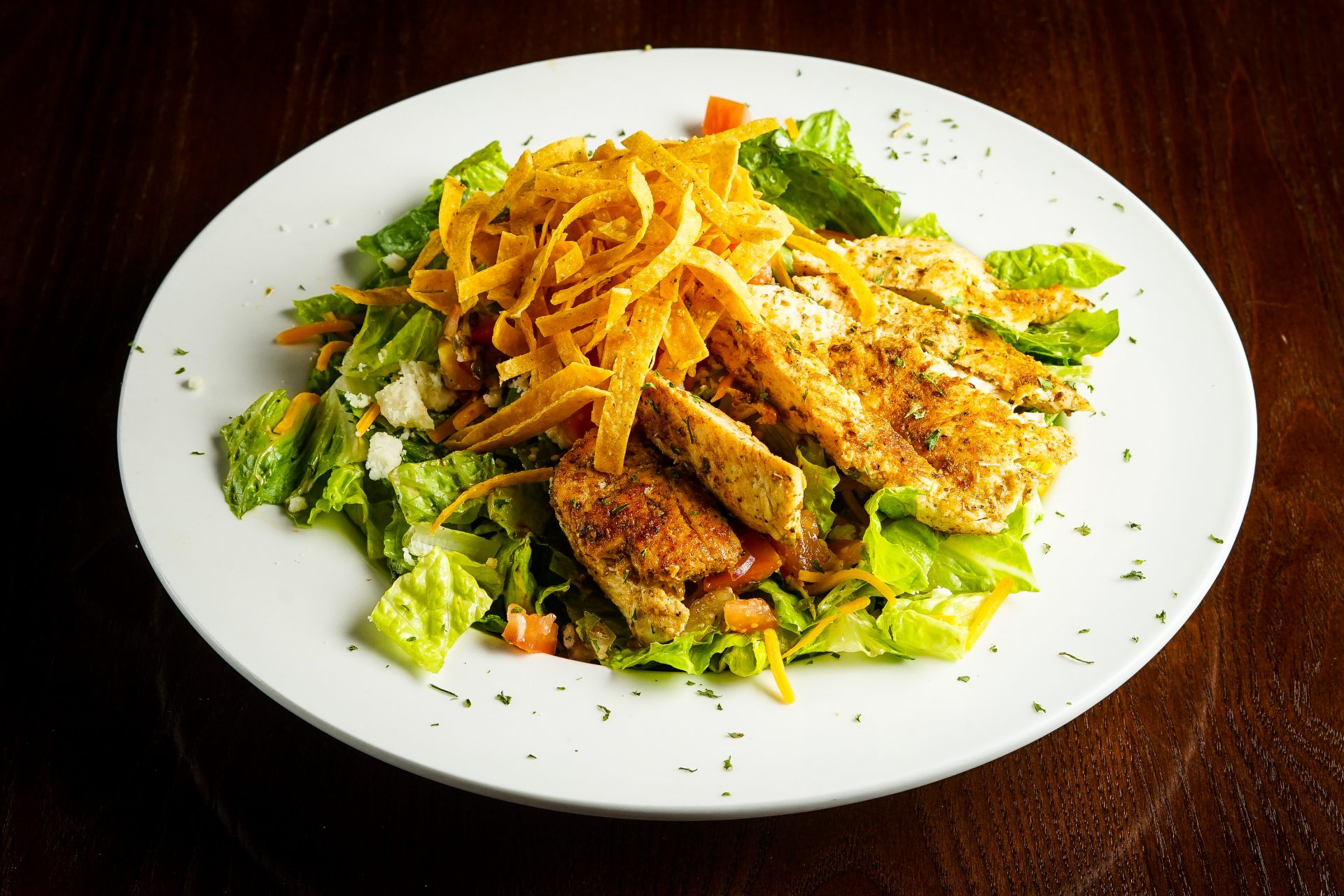 Image of New Mexico Salad - Blackened Chicken, Pico de Gallo, Queso Fresco, Cheddar Cheese, Corn Tortilla Strips, Romaine Lettuce, Chipotle Ranch Dressing