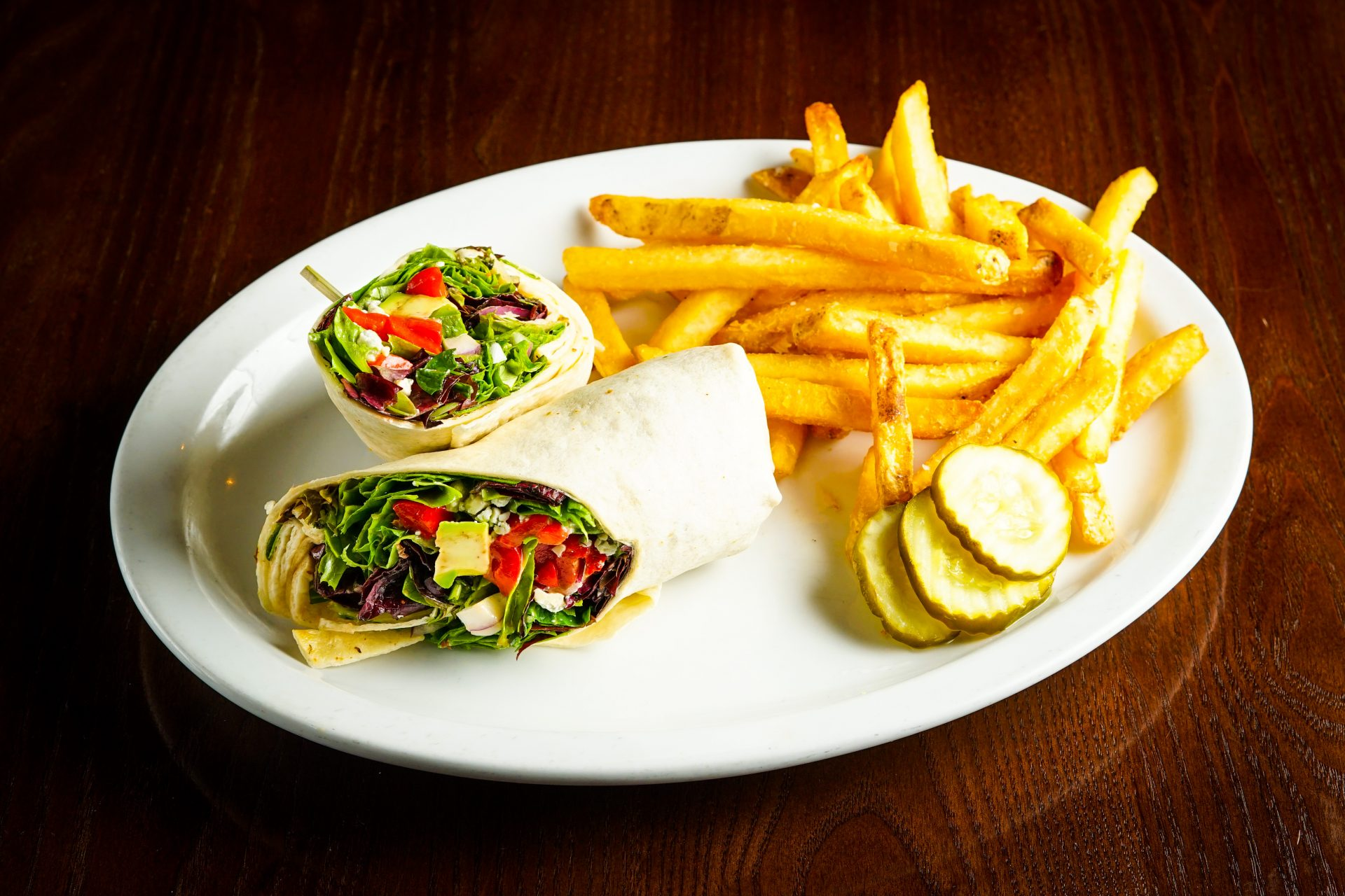 Image of California Wrap - Avocado, Red Onion, Roasted Red Pepper, Bleu Cheese, Mixed Greens dressed with Champagne Vinaigrette, Flour Tortilla