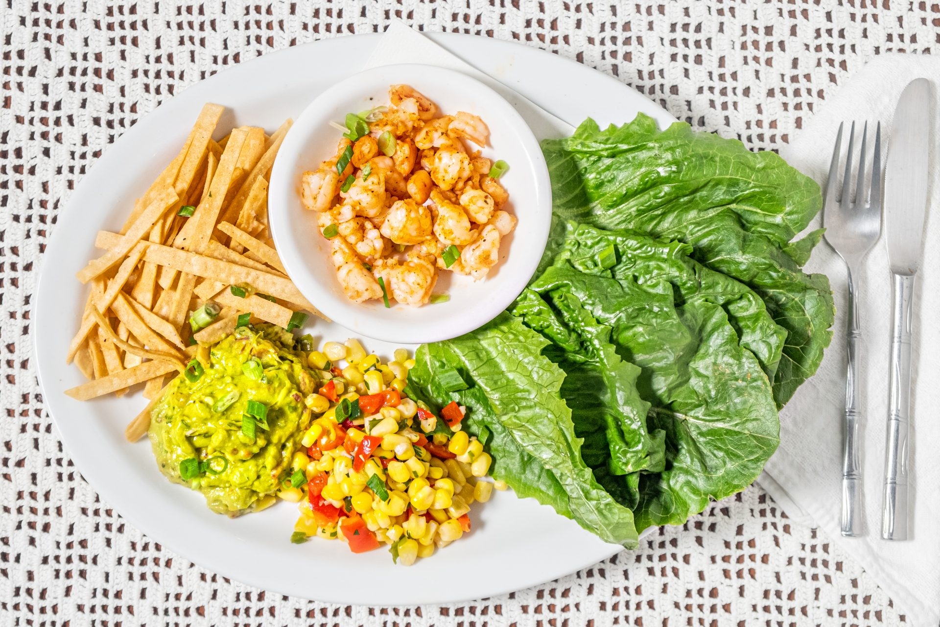 Image of SoCAL Lettuce Wraps - Spicy Chopped Shrimp, Corn Salsa, Guacamole, Roasted Peppers, Corn Tortilla Strips, Romaine Lettuce Wraps